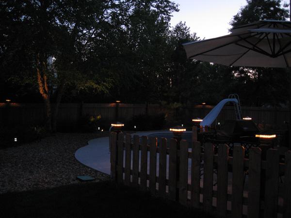 Deck lights on a fence in Overland Park, KS.