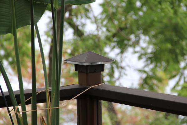 Smooth, Roman Bronze Deck Light / Lighted Post Cap. On a 4x4 post.