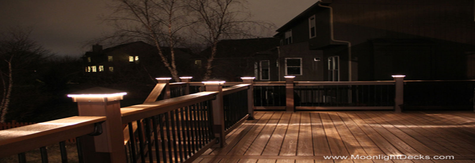 Low voltage deck lighting with lighted post caps.