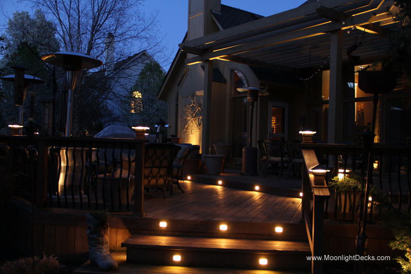 Low voltage deck lighting with lighted post caps and step lights.