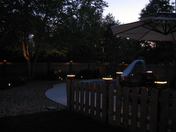 Deck lights on a fence in Overland Park, KS.