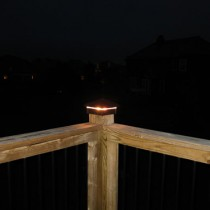 Hammered Post Cap / Deck Light at night.