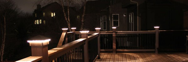 Deck lights, deck lighting, low voltage lighted post caps at night.