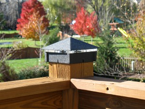 Smooth black wrinkle lighted post cap / deck light.