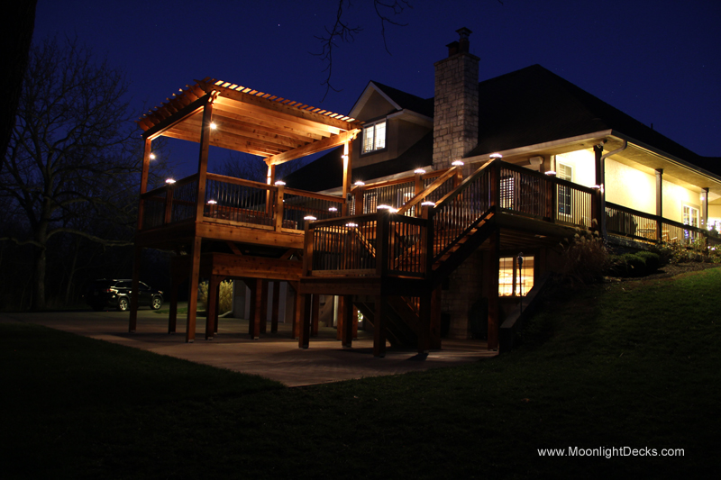 Deck lighting with low voltage lighted post caps / deck lights.